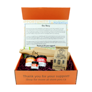 Gift box with 3 jars of jam, a small baguette board, and coffee.