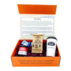 Gift box with one jar of jam, a half-pound of coffee, a coffee tumbler, and two chocolates.