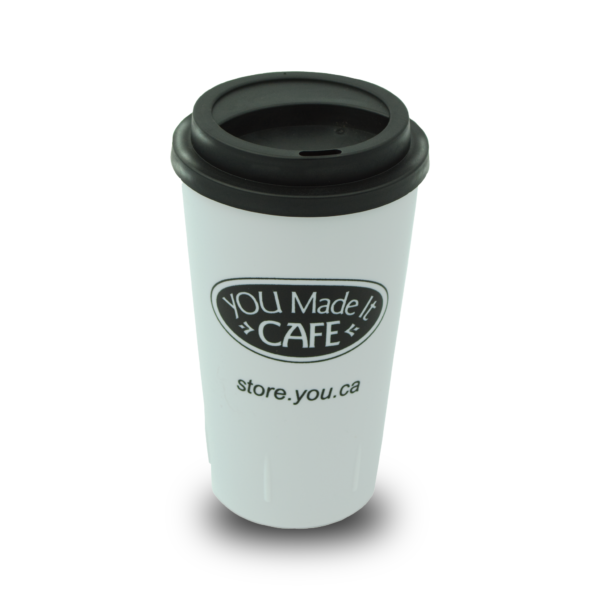 White Coffee tumbler with YOU Made It Cafe logo.