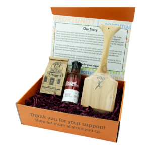 Gift box with bbq scraper, bbq sauce, and half-pound bag of coffee.