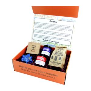 Gift box with half-pound bag of coffee, set of 4 wood coasters, 2 jars of jam, 2 chocolates.